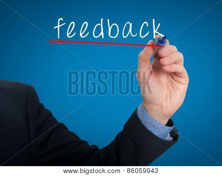 Businessman hand writing Feedback in the air - Stock Image