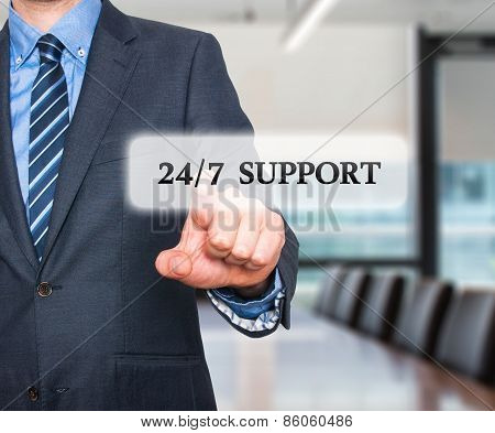 Businessman pointing at 24/7 support  services. Internet online support business concept