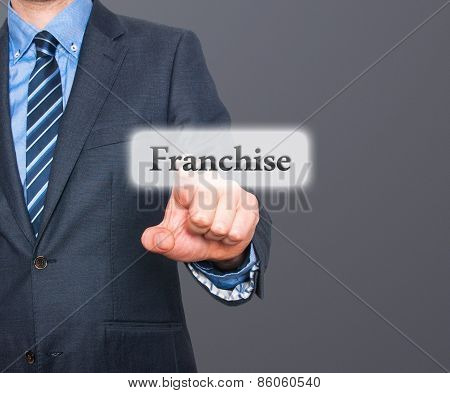Business concept businessman pointing Franchise. Isolated on grey background.