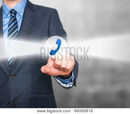 Businessman pressing phone button on visual screen. Customer support concept.