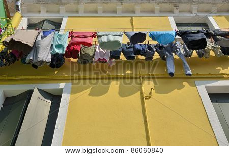 Laundry On On Yellow Facade