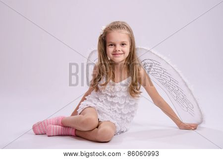 Sitting Girl In Angel Costume