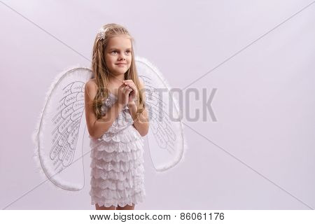 Girl Dressed As An Angel With Wings Folded Hands