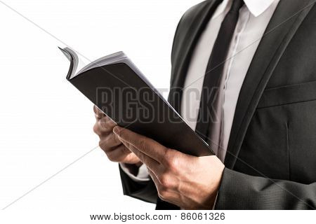 Businessman Reading From A Notebook