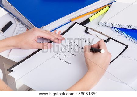 Human Hands With Pen Filling Customer Survey Blank