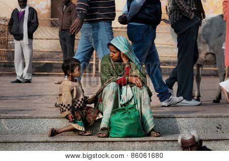 Indian Mother And Son Talking On The Street At The Temple