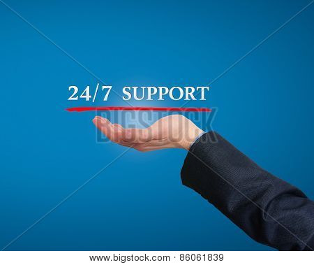 Businessman pointing at 24/7 support services.