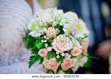 Pastel wedding bouquet with roses