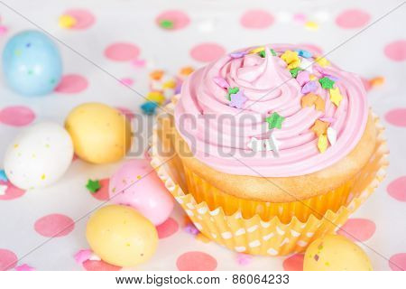 Pink Easter Cupcake With Candy And Sprinkles