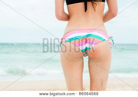 Close-up of young woman buttocks