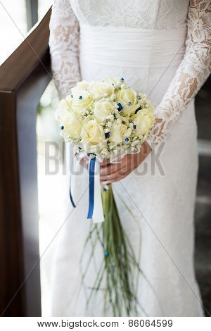 White wedding bouquet with roses