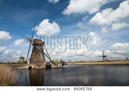 Tradi tional dutch windmill near the canal. Netherlands