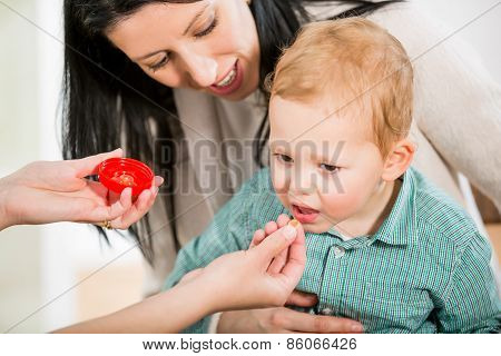Young woman and her child at the doctor homeopaths.