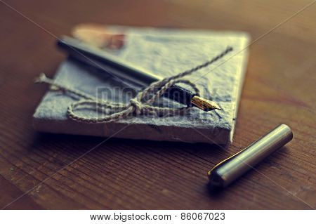 Old Diary Memories With Fountain Pen On A Wooden Table