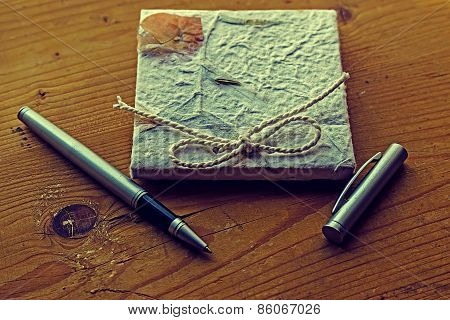 Old Diary Memories With Pen On A Wooden Table 1