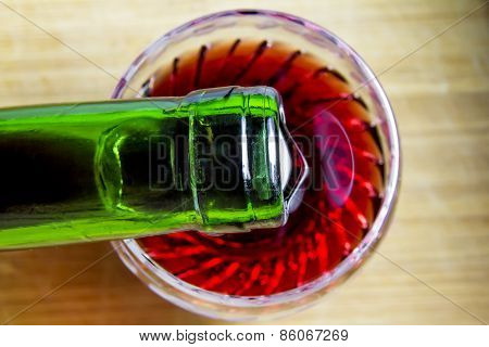 Wine Is Poured Into A Glass, Top View
