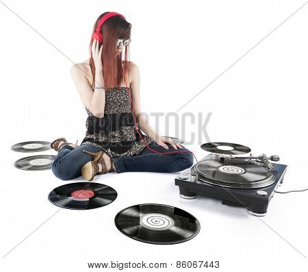 Young Woman Listening a Music From DJ Turntable