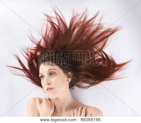 Woman Lying on the Floor with Windblown Hair