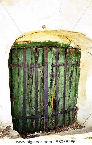 Green door to old wine cellar