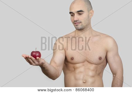 Bodybuilder Holding A Red Apple.