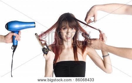 Hairstylists Styling the Hair of a Young Woman