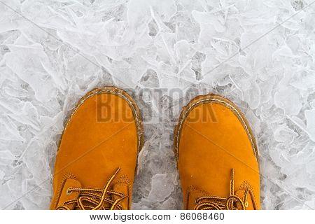 Orange Boots On The Ice