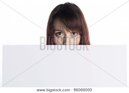 Young Woman Peeking Behind White Cardboard