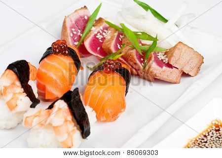 The sashimi plate with shrimps, salmon and tuna