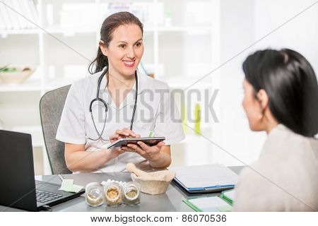 Alternative Medicine - Homeopathy.Young woman in an office at the doctor homeopaths.