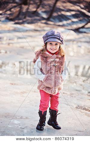 spring outdoor vertical portrait of happy child girl