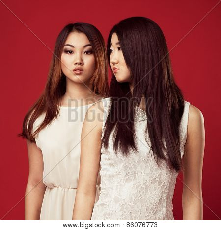 Two Beautiful Fashionable Women In White Gowns