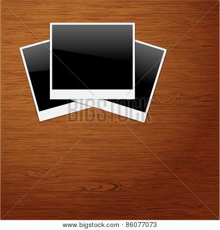 Polaroid Photo Frames on Wooden background