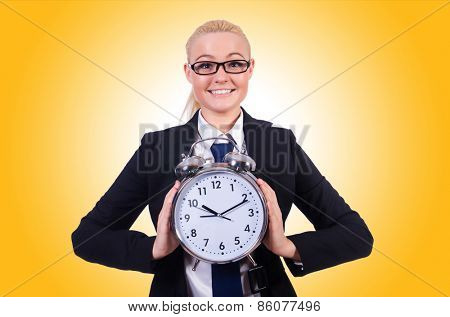 Woman with giant clock on white