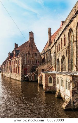 Medieval street in the old and famous city of Bruges in Belgium (shot from public ground, no copyright for architecture as these building exteriors are over 400 years old).