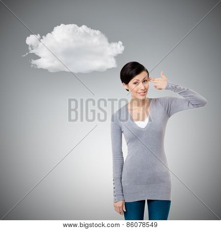Young girl shows hand gun gesture, isolated on grey