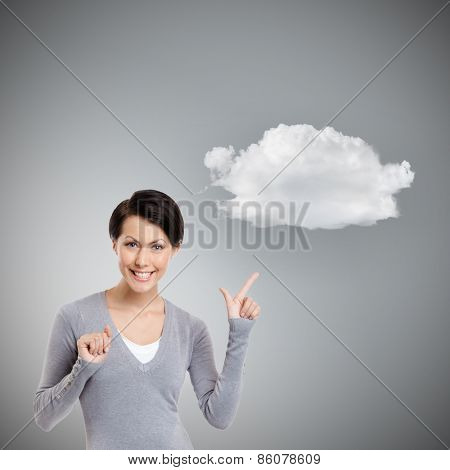 Pointing finger up to cloud, isolated on grey