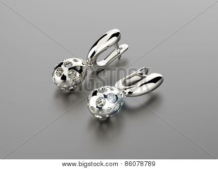 earring  in egg shape with diamonds. Jewelry background