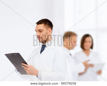 medicine, profession, and healthcare concept - serious male doctor with clipboard writing prescription over white background