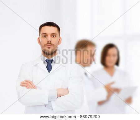 healthcare, profession and medicine concept - male doctor in white coat over white background