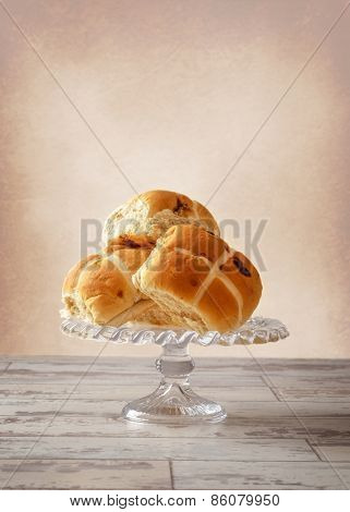 Easter Hot Cross buns on glass stand