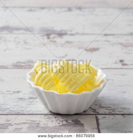 Butter curls in white serving dish