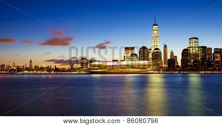 Lower Manhattan in New York City at sunrise with cruise ship passing by