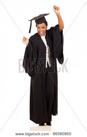 happy young african female university graduate dancing on white background