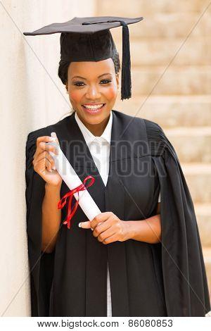 beautiful afro american graduate holding diploma