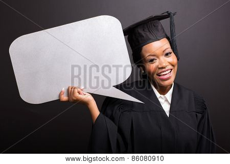 young afro american graduate with blank text bubble isolated on black