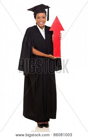 happy african female graduate holding red arrow isolated on white