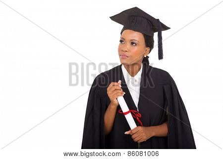 thoughtful african female graduate looking at empty space