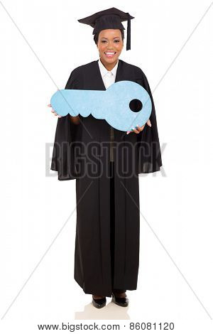 african female graduate showing paper key isolated on white background