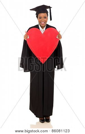 beautiful african college graduate holding heart shape on white background