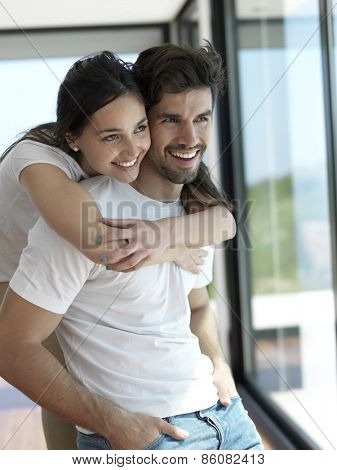 romantic happy young couple relax at modern home indoors and have fun